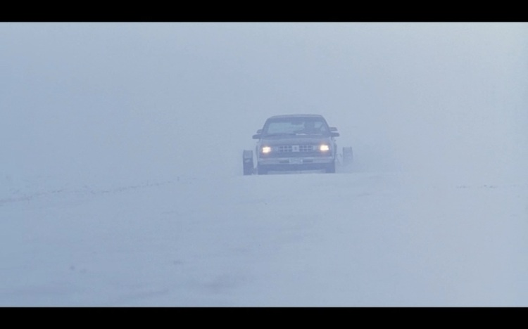Car driving through snow in Fargo